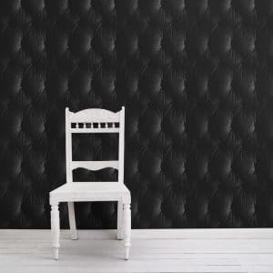 Chesterfield Wallpaper in black colour with a white chair