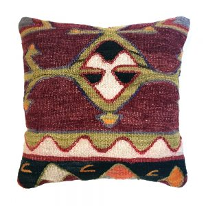 an original kilim rug cushion with a tribal wave pattern in plum and green