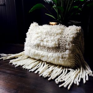 Fringed Apaloosa cushion in pure wool with plants