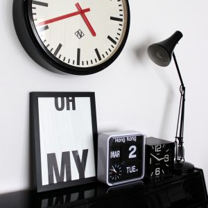 Oh My art print by We are Amused in black text on white background displayed with monochrome clocks on a mantle piece 30 x 40