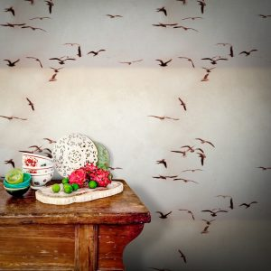 Portugese Seagulls Wallpaper by Feathr in Vintage colour with wooden table and crockery