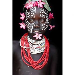 Omo valley African tribe girl with flowers.  Photo taken by Mario Gerth for sale at curiousegg.com