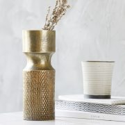 Ukku vase in cast bronze with books and cermaic cup