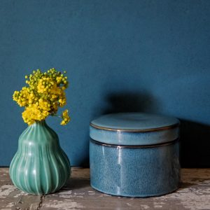 Blue ceramic glazed box and vase with yellow flowers