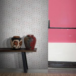 Tips Wallpaper in Fire Colour by Feathr at Curious Egg.  Lifestyle image with decorative vases displayed on a bench in the foreground and a pink painted wall.