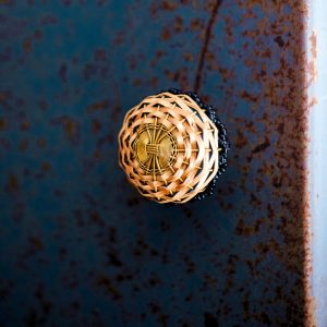Rattan door knob with beads on blue distressed panel