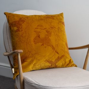 Daniel Heath taxidermy Birds Velvet Cushion in Gold Colour on armchair