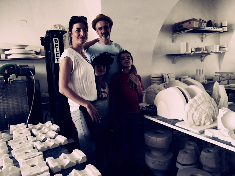 Daniel and Tereza Pirsc with their kids in his porcelain workshop image: Curious Egg