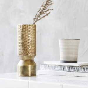 Curious Egg Nuru vase in gold finish lifestyle image