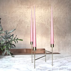 Hand dipped taper candles in Rose petal colour in gold candle stand
