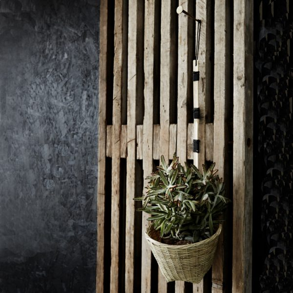 Bamboo Hanging Scoop Basket against grey distressed wall