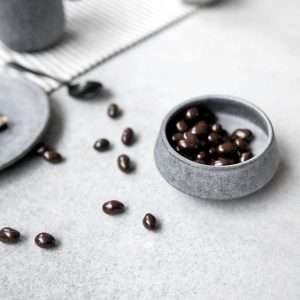 Ceramic snack bowl with coffee beans in it