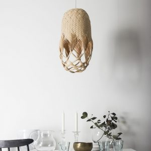 Pren Shadow 06 - hand woven sculptural rattan light fitting y Louise Tucker hanging above table with crockery and glassware