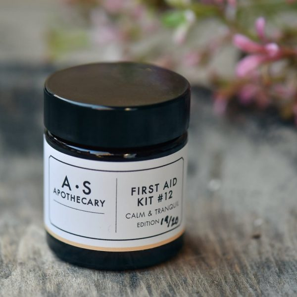Calm & Tranquil therapeutic organic skincare balm by AS Apothecary on rustic table