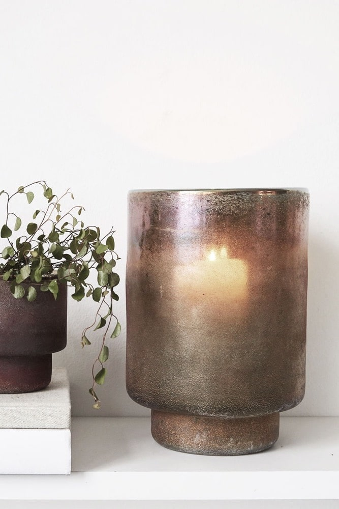 This is a planter but not as we know it - it has a hidden purpose! Its name gives away its molten like surface, which changes colour in the light from golden pinks to browns and dark crusted charcoal greys, greens and blues. This beautiful vessel can be used as a planter by day but the magic truly comes at night. In the evening, light a candle inside the vessel and watch the surface of the glass become semi translucent, radiating the most entrancing glow - perfect for the longer evenings ahead!
