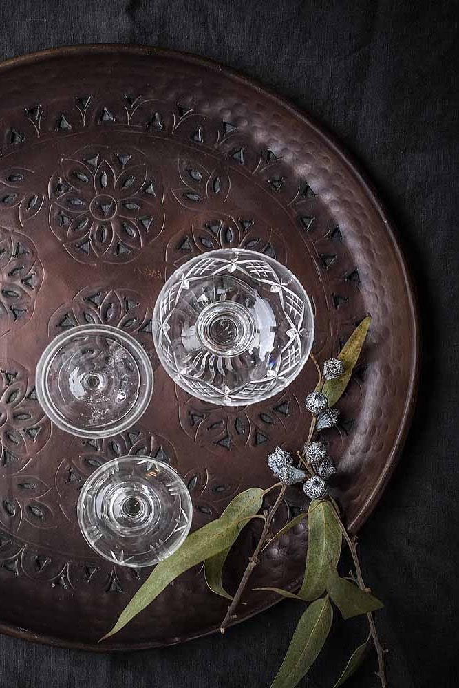 This beautiful serving tray has a decorative cut out pattern and antique bronze finish making it a gorgeous accessory to have on permanent display on a coffee table, or console. Set up with a decanter and your favourite glasses and you'll be ready for impromptu entertaining at any moment. It's also a generous enough size to arrange small bowls with dips and casuals bites - everything tastes better when its served in style!