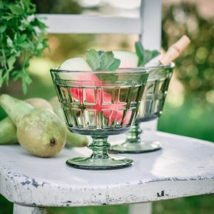 green cocktail glass in summer scene