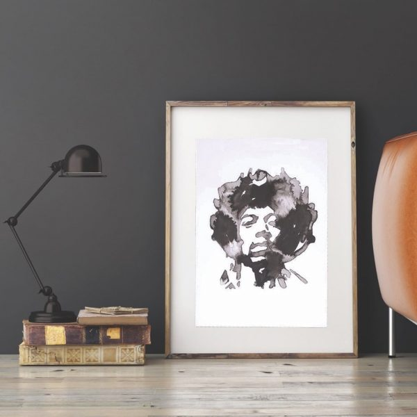 ink blot style image of Jimi Hendrix art print by Jenn Rea leaning against a wall beside a leather sofa
