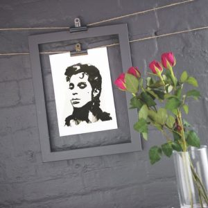 ink blot style image of Prince  art print by Jenn Rea hanging against a dark grey wall