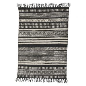woven tribal rug with North African and Arabian style patterns in black and off white