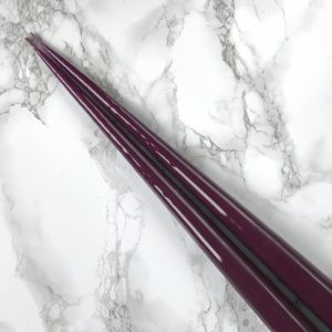 Pair of hand dipped taper candles in laquered Aubergine colour. Curious Egg.