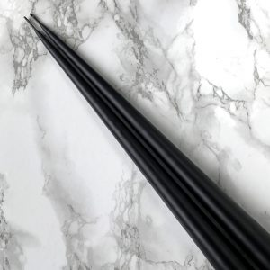 Pair of hand dipped taper candles in Black colour. Curious Egg.